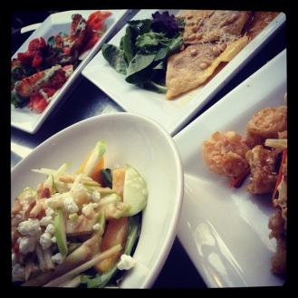 (Top Left) Fried Green Tomato, Smoked Salmon, and Mozzarella Salad with Basil Crema at Bizou Restaurant.